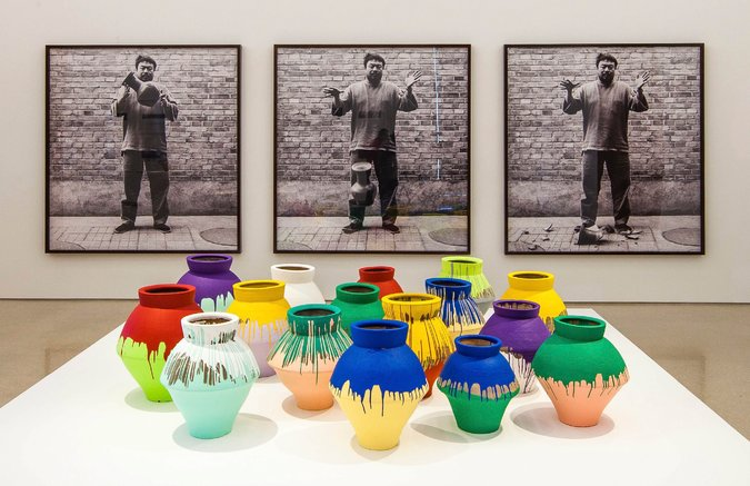 """Colored Vases"" with ""Dropping a Han Dynasty Urn"" in the background. Artist is Ai Weiwei. The vases are an installation of painted Han vases. The photograph in the back is from 1995, the installation itself is from 2014."