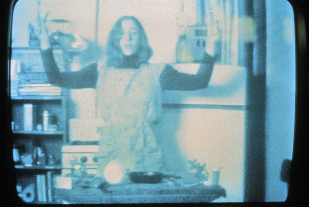 Still from: Martha Rosler, Semiotics of the Kitchen, 1975. Video